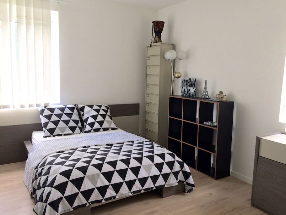 Second Room with a big double bed ! + Cupboard and Chest of drawers and book storage furniture + Office table in each room