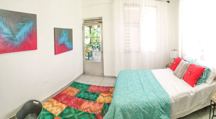 Bright and clean bedroom that walks out to the shared covered patio