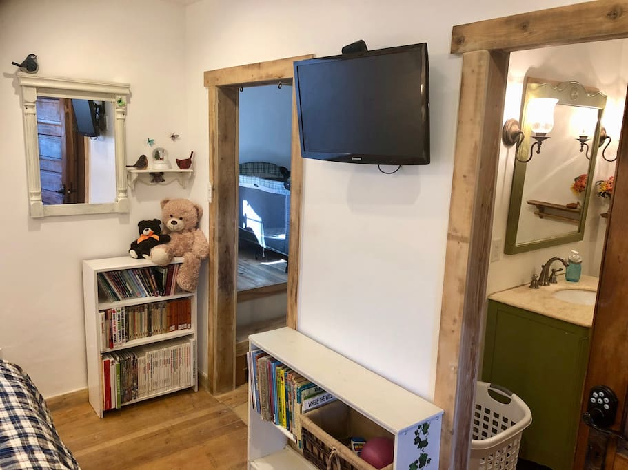 The master bedroom has its own flat panel TV with attached Apple TV and Netflix account.  There are some children's books on the shelves. and you can see the pack-and-play crib in the upper section of the closet.  You'll also love having your own private bathroom.