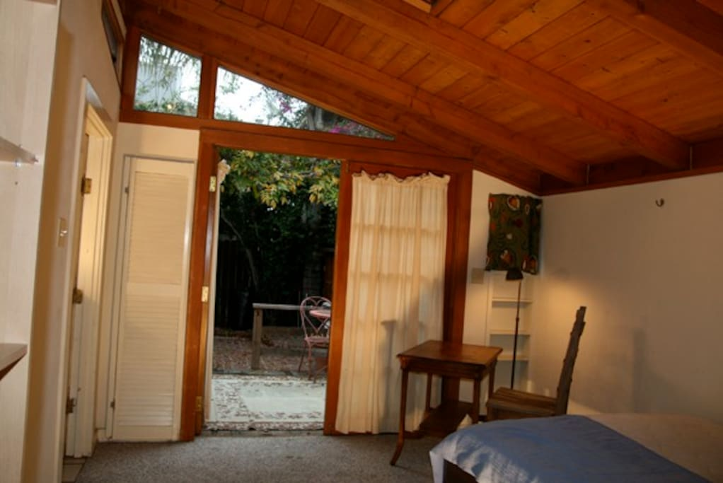 View of studio looking out to patio.  This is a no-smoking property.  Double bed.  The studio has WiFi for your laptop, but no TV.