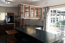 The Kitchen includes a breakfast bar which overlooks a cool, shaded section of the garden.
