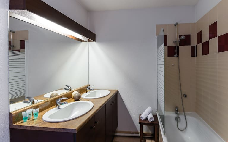 The bathroom is bright and has everything you need to get ready for your day.