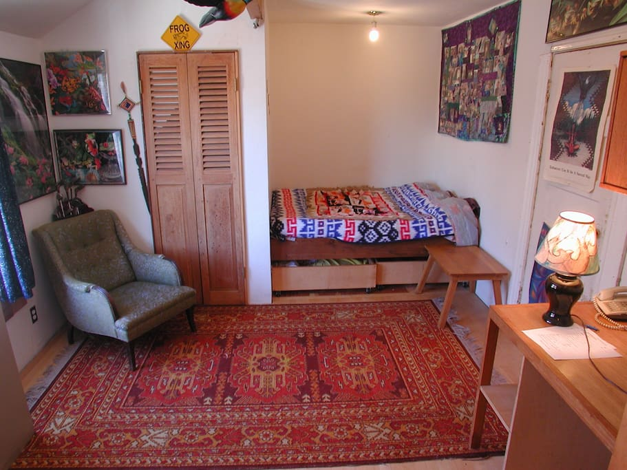 Your room:  Comfy chair, bed.