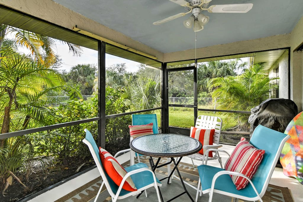 This home offers a lanai with a pool, along with a screened-in porch.