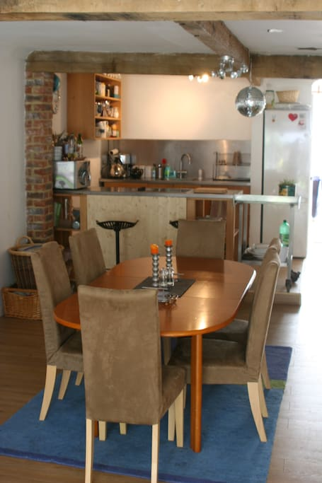 Dining area and stainless steel kitchen