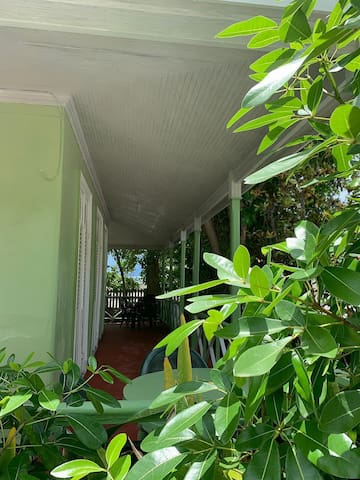 Guests front porch to chill and enjoy your meals !