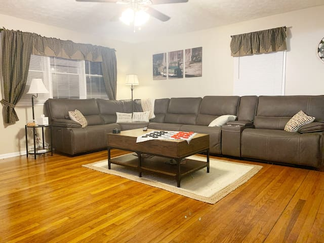 Large living room with plenty of seating. Three reclining sections of the couch!