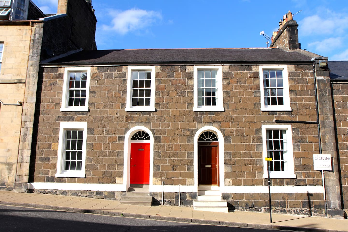 Our Stirling townhouse is really old, built 1824. It's the one on the left, red door.