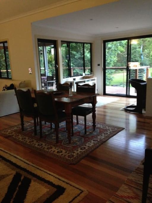 View through open plan living area through to sun deck and river reserve beyond