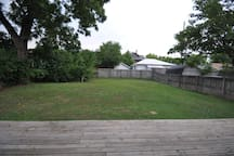 Large, fenced-in back yard.