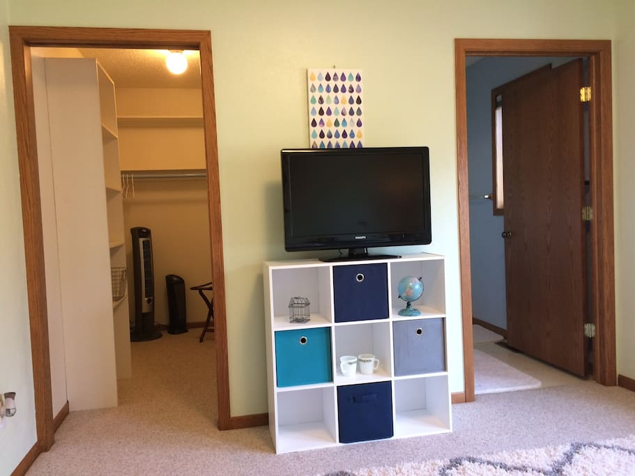 TV is available upon request. No cable connection. Wifi only. Walk in closet on the left, on suite bathroom on the right