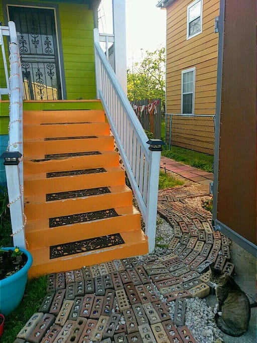 The path leads from the front of the house to the guest studio at the back.