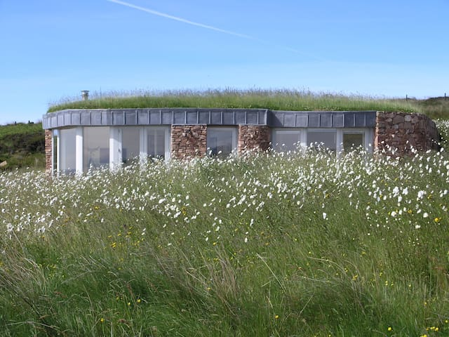 Turf roofed self catering lodge
