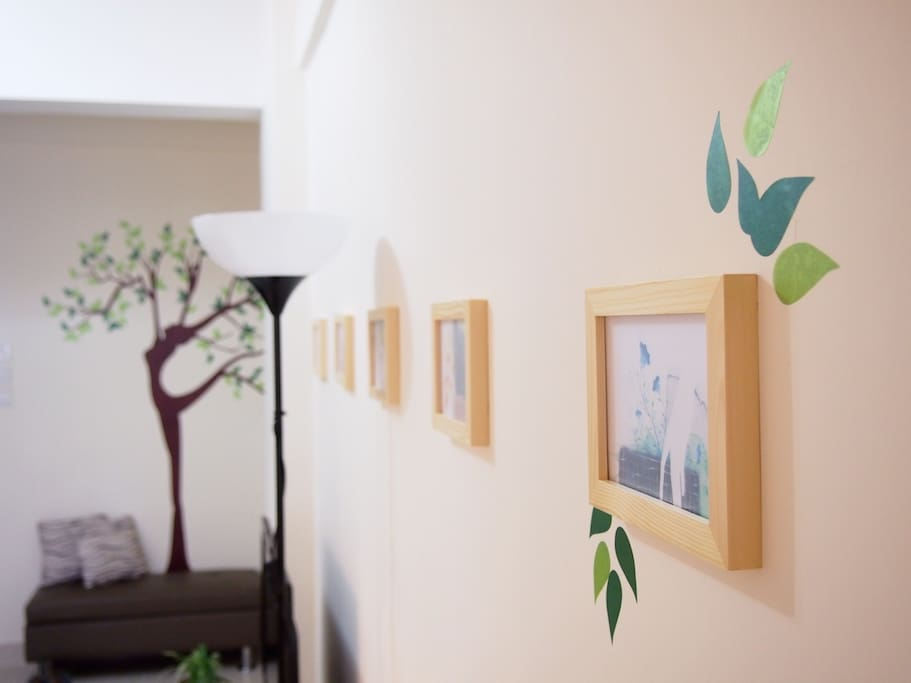 there are plant, frame and wall decor to make a fresh and cozy atmosphere for your stay