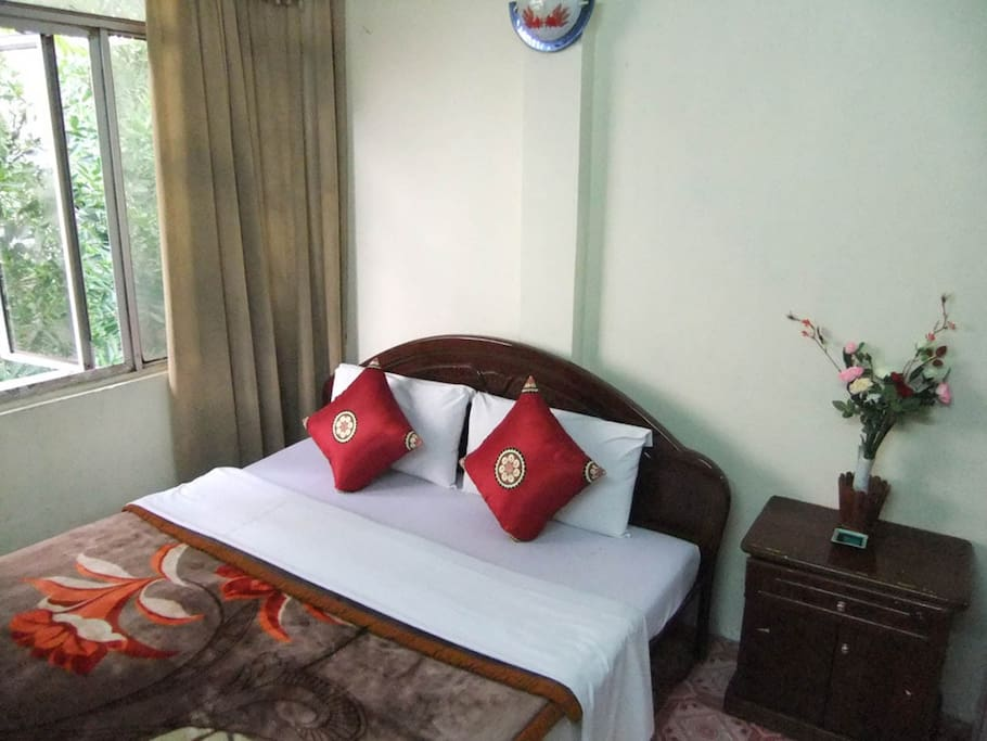 Double bed room 103. The room includes a private bathroom, fan, air conditioning, heating, and flat-screen TV.