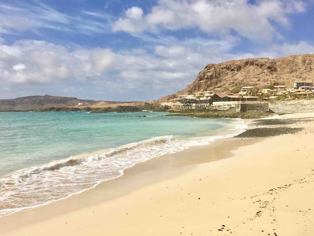 Praia da Cruz beach right in front of the building is perfect for swimming and enjoying the beauty of Atlantic Ocean