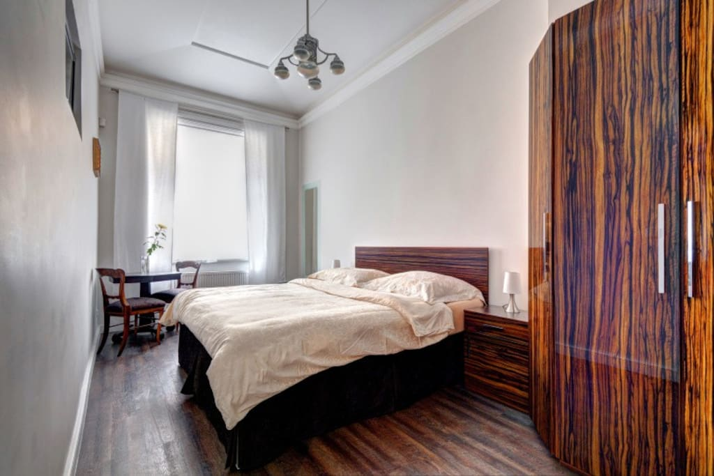 The bedroom with comfortable double bed and large wardrobe.