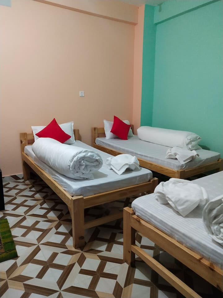 Sharing room for 3 people with triple bed and bath