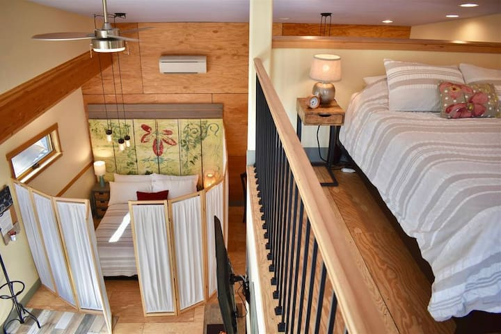 """View from stairs of lower & upper Queen bed """"rooms"""".    Upper Queen bed is accessed via a """"cozy"""" spiral staircase (not good for people with physical limitations)."""