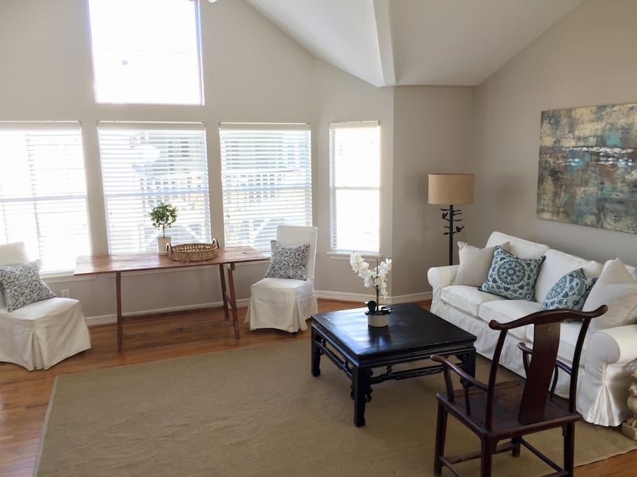 Upstairs duplex unit is light and bright; covered parking available below.