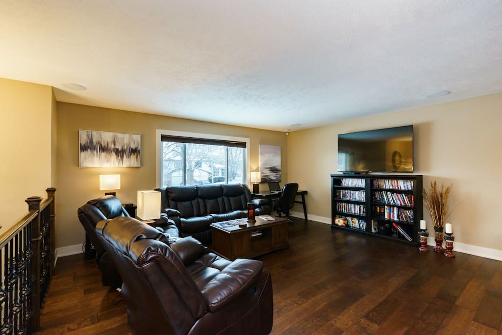 Spacious living room with large SMART TV