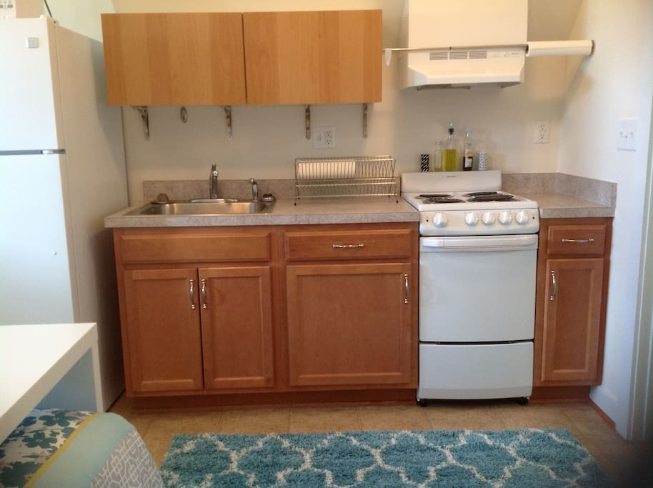 KItchen has a full refrigerator with freezer, oven, stove, and microwave. Dishes and silverware are also provided.