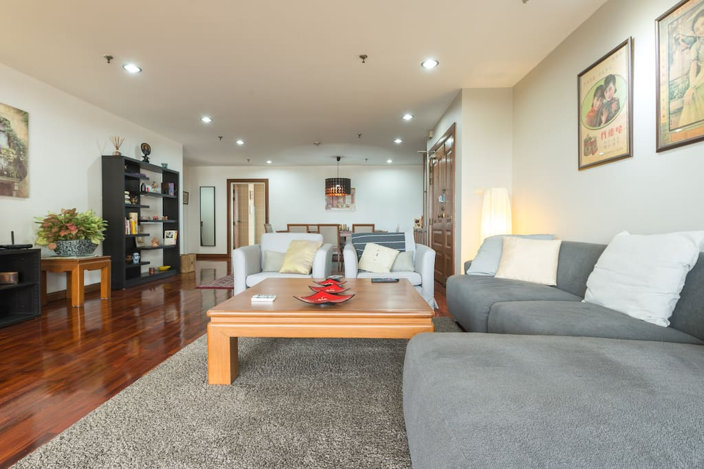 Grand room - living and dining tastefully decorated with comfortable sofa and large coffee table
