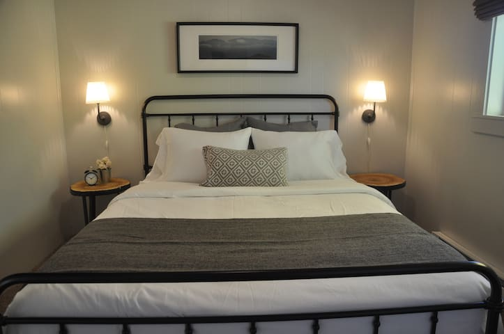 Bedroom #1 has a comfortable queen size memory foam mattress with high quality bedding and a wardrobe for hanging clothes.