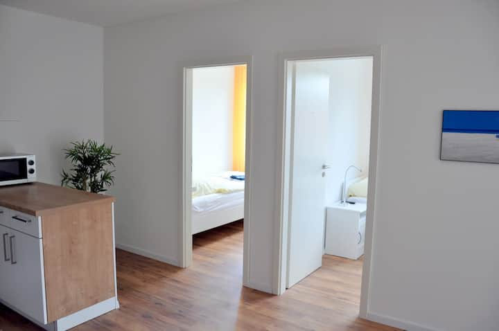 2 single- and 1 double- bedroom apartment
