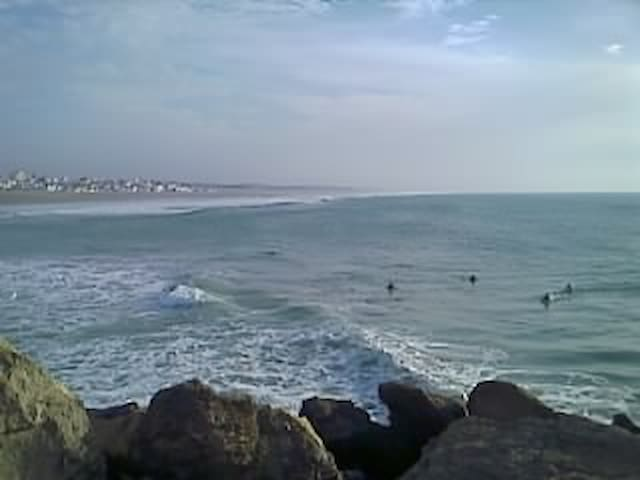 Surfers come from all over the world to defy the waves if Mehdya plage