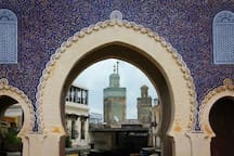 Fes is 3-4 hours away by train or car or bus