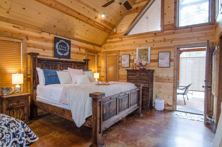 """Dream Weaver is a beautiful,honeymoon style cabin. Perfect for honeymooners, anniversary, or small families! Enjoy the outdoor fireplace or hot tub. 1 bedroom """"honeymoon suite"""" – sleeps 4 –Kaniatobe Trails South –Pets allowed, fee required."""