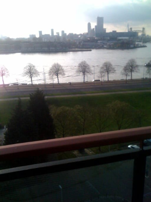 your balcony for evening dinners with sunset over rotterdam skyline
