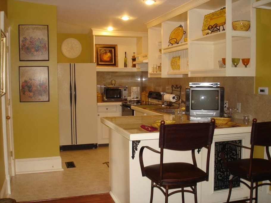 The kitchen is fully equipped for meals at the marble counter. WiFi and Direct TV are included.