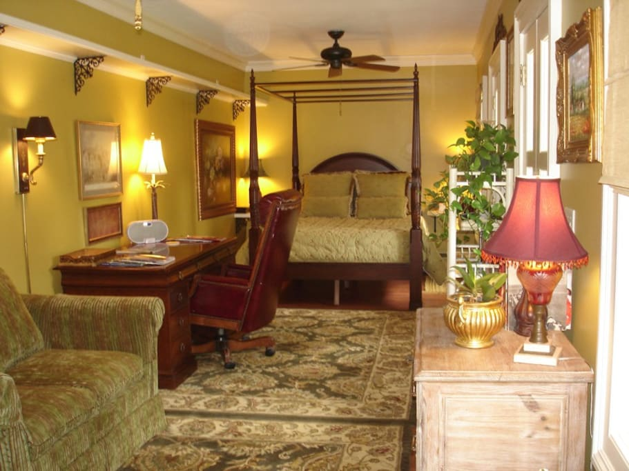 This is the long view of the interior, looking from the kitchen toward the bed. The loveseat pulls out for a bed.