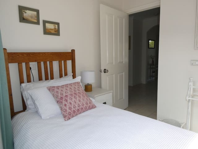 Small but comfortable single bedroom with built in wardrobe.