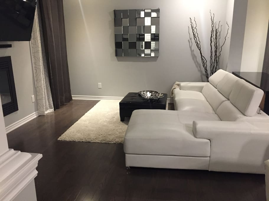 Modern cozy family room with plenty of natural sunlight , electric fireplace and oversized flat screen smart TV , Netflix , Dvd /Blue Ray