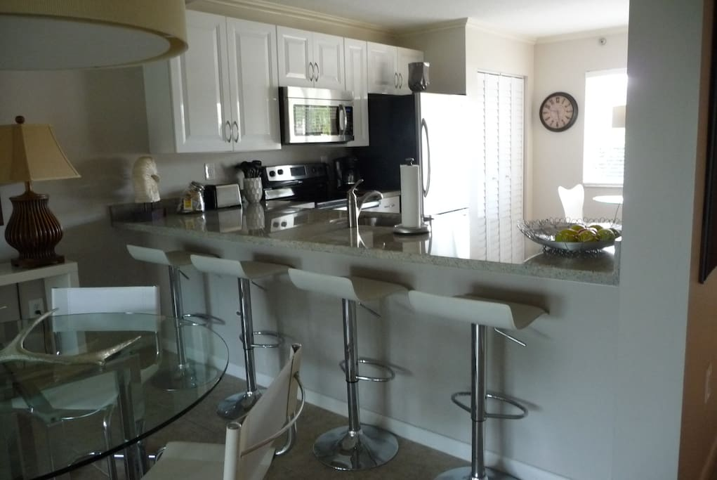 Beautiful completely remodeled kitchen with granite and open concept living/dining.