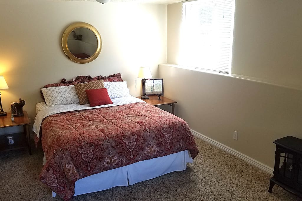 Master bedroom- queen sized bed plus a sitting area
