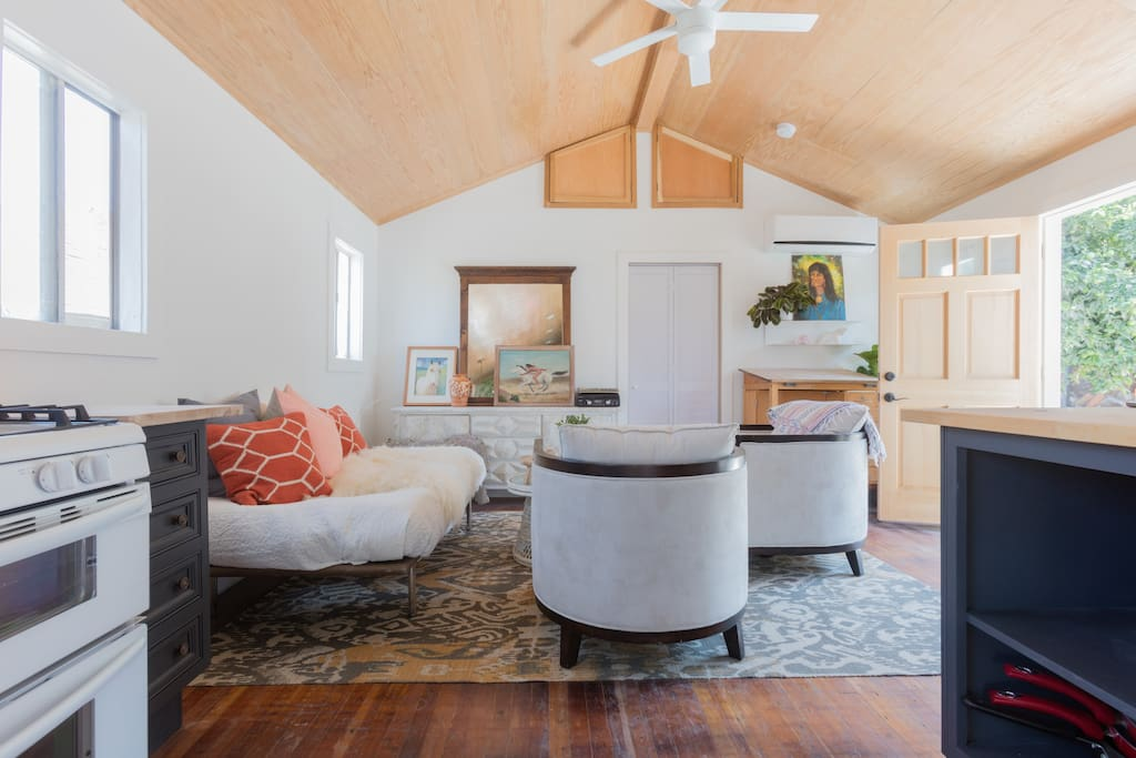 View of living room from kitchen, light, airy, vaulted ceilings