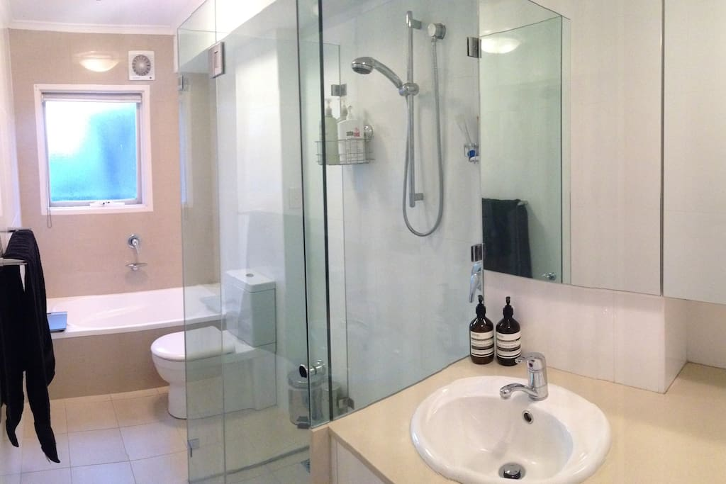 Clean and modern Bathroom with washer dryer available.