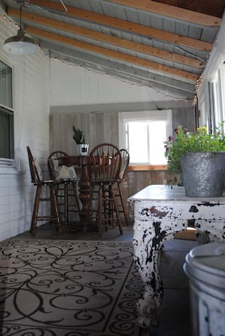 Three season porch - perfect for viewing the sunsets, wildflowers and pumpkin garden!