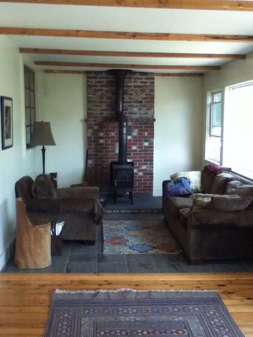 Living area, with a wood stove and very comfortable couch!