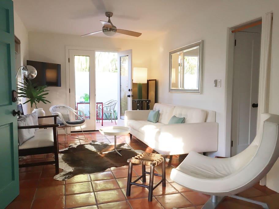 living room with doors to courtyard garden