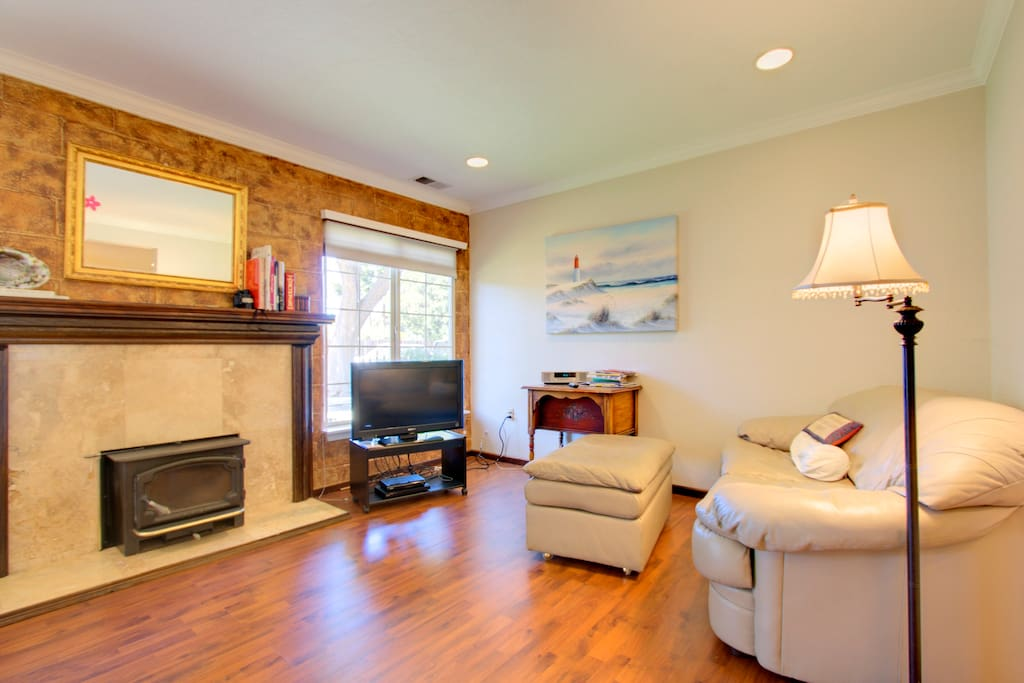 clean comfortable uncluttered living room with cableTV