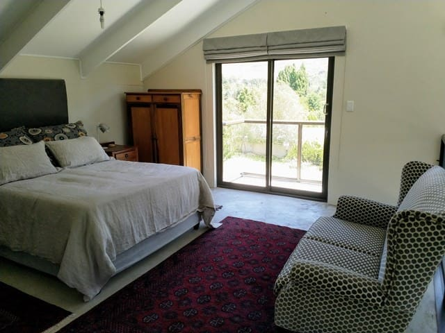 Main Bedroom with queen size extra length bed and private balcony