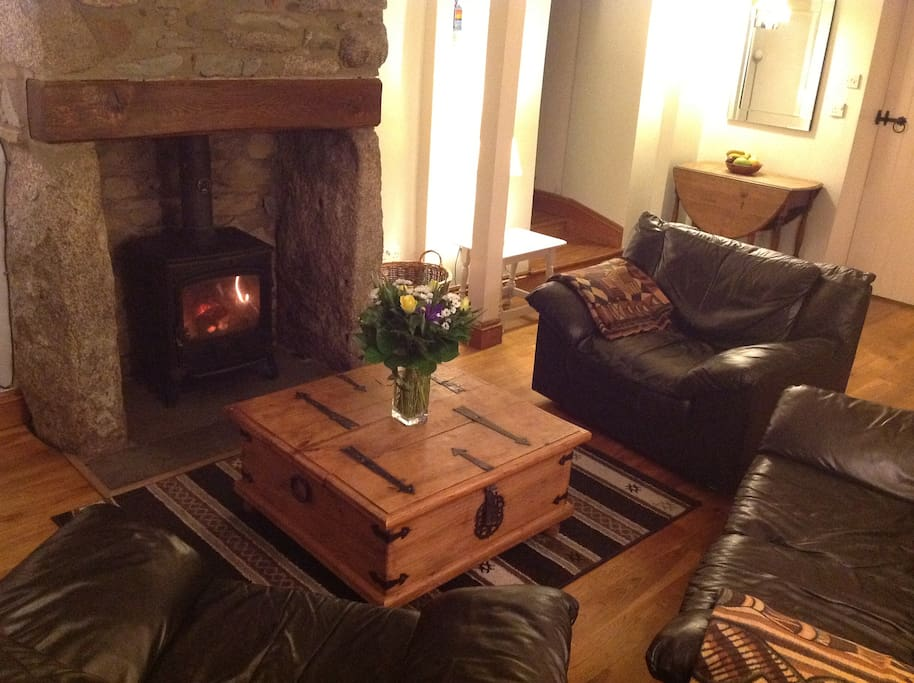 Cosy cottage lounge, the perfect place to relax and unwind in front of the fire