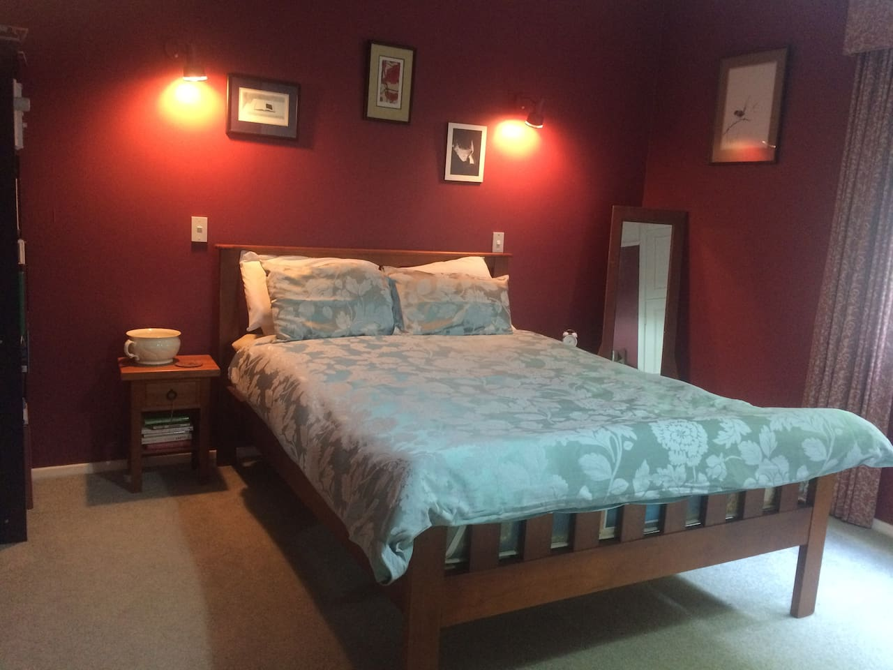 Peaceful double room with queen bed and plenty of storage for luggage.