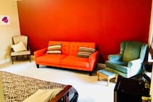 Single private room. Furniture changes to accomodate extra beds. (Orange futon no longer there to fit beds)