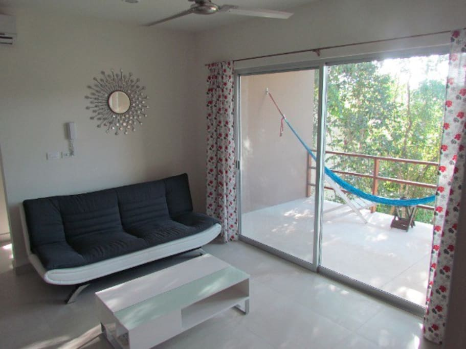 Open living room with balcony